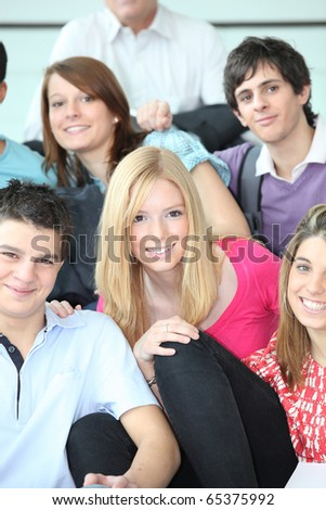 Group of pupils sitting on stairs - stock photo