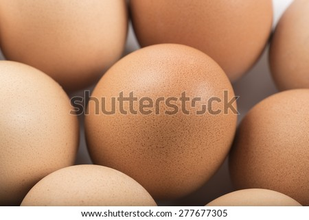 group of raw eggs, closeup on white background - stock photo