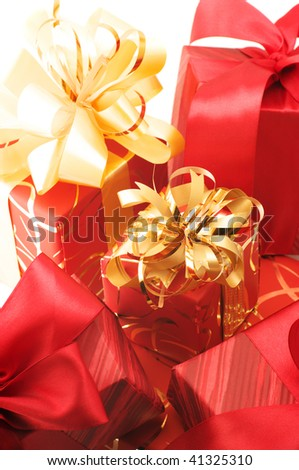 Group of red and gold gifts close-up.