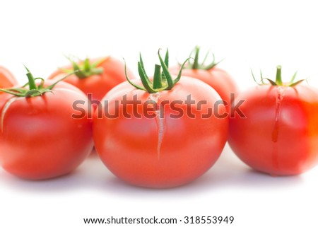 Group of red fresh tomatoes isolated on white background - stock photo