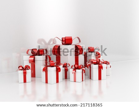 Group of red ribbon gift boxes against white reflective blank wall - stock photo