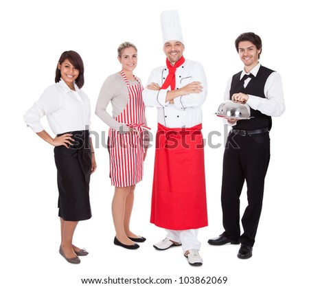 Group of restaurant chef and waiters. Isolated on white