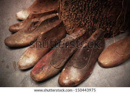 group of retro wooden shoe production make mold  form shape, layered with grungy style texture graphic - stock photo