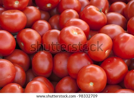 Group of ripe fresh red tomatoes on a market