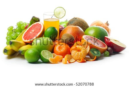Group of ripe fruits and glass with juice - stock photo