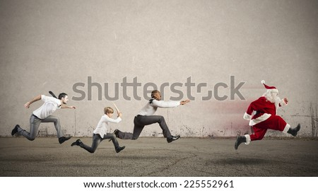 Group of runner angry person chasing Santa Claus - stock photo