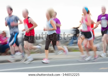 Group of runners compete in the race, blurred motion. People  are not recognizable - stock photo