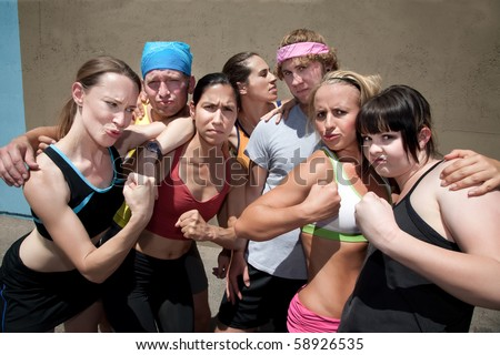 Group of runners pose after a race. - stock photo