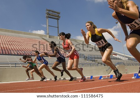 Group of runners starting race - stock photo