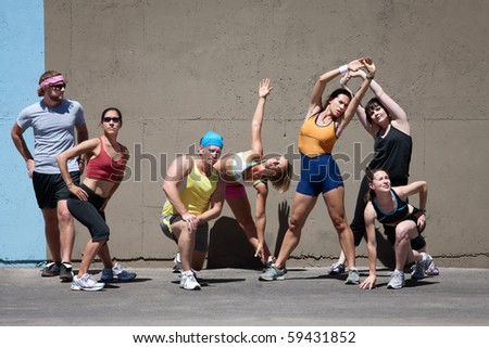 Group of runners stretches before going for a run. - stock photo
