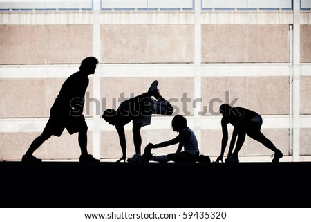 Group of runners stretching before race. - stock photo