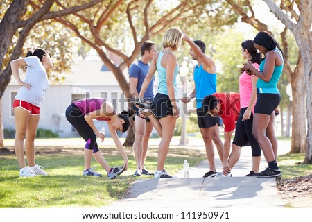 Group Of Runners Warming Up Before Run - stock photo