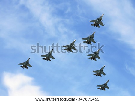 Group of russian fighters flying in a blue sky - stock photo