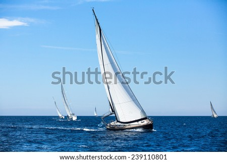 Group of sail yachts in regatta in open the Sea. Boat in sailing regatta. Luxury yachts.  - stock photo