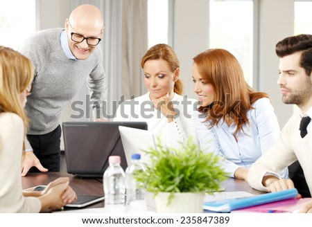 Group of sales people working on business project. Teamwork at office.  - stock photo