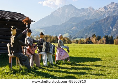 Group of scarecrows in female dress standing on a field, Austria