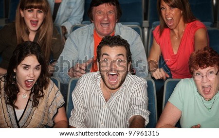 Group of scared people screaming in their seats - stock photo