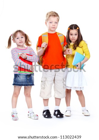 Group of school children isolated on white background looking confidently at camera - stock photo