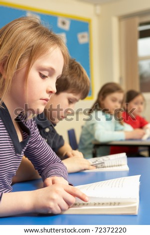 Group Of School Children Working In Classroom - stock photo