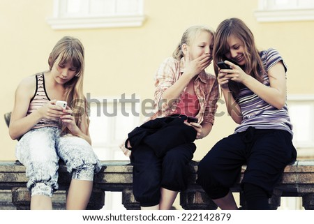 Group of school girls calling on the cell phones - stock photo