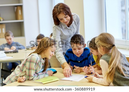 group of school kids writing test in classroom - stock photo