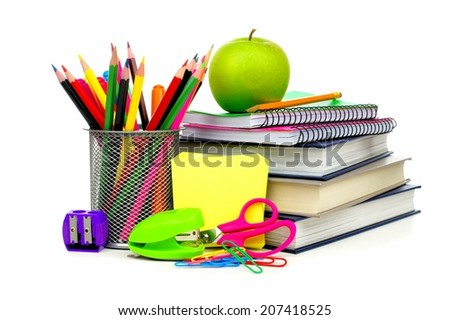 Group of school supplies and books over a white background - stock photo