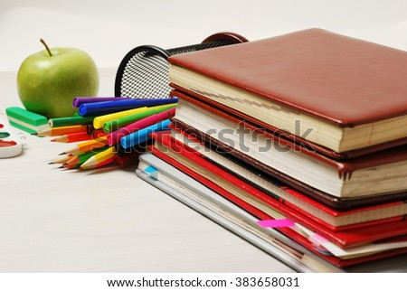 Group of school supplies, books, diaries, and mobile phone on top isolated on white background with space for text - stock photo