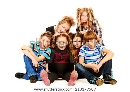 Group of schoolboys and girls sitting with laptop. Isolated over white. - stock photo