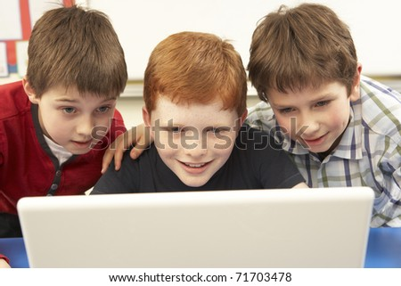 Group Of Schoolboys In IT Class Using Computer - stock photo