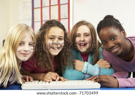Group Of Schoolgirls In IT Class Using Computer - stock photo