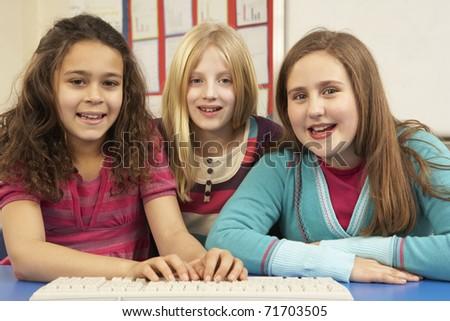 Group Of Schoolgirls In IT Class Using Computer - stock photo