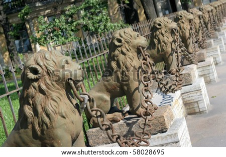 Group of sculptural images of lions - stock photo