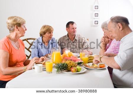 group of senior friends having breakfast - stock photo