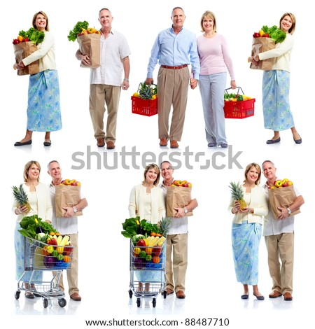 Group of senior people holding shopping bag with food products. Isolated over white background. - stock photo