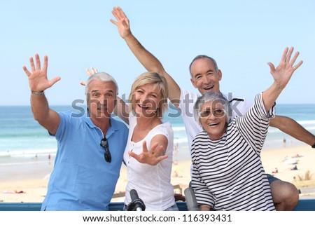 group of senior people on the beach - stock photo