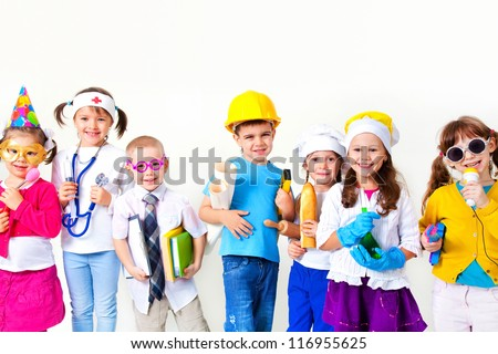 Group of seven children dressing up as professions - stock photo