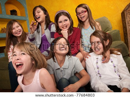 Group of seven happy little girls laugh out loud - stock photo