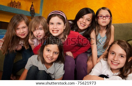 Group of seven happy little girls smiling - stock photo