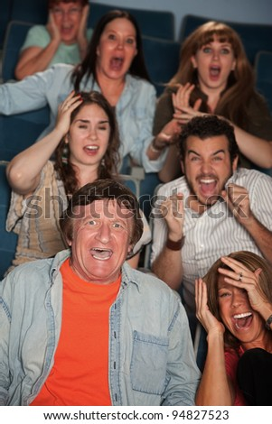 Group of seven horrified men and women react - stock photo