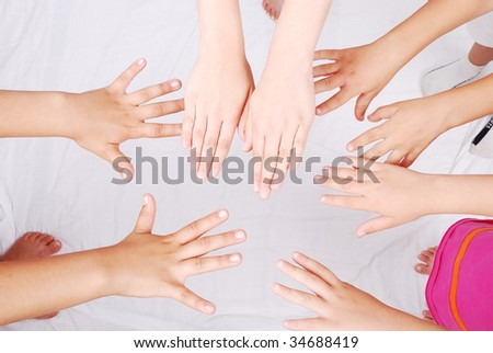 Group of several pairs of children hands - stock photo