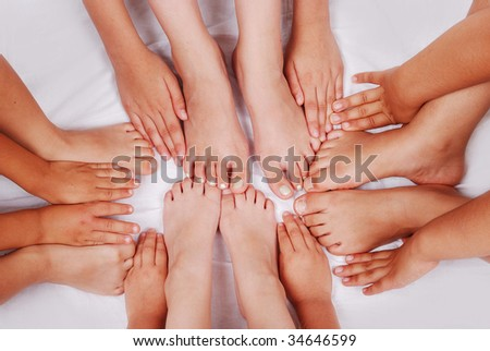 Group of several pairs of children hands and legs - stock photo