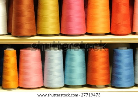 Group of sewing threads in two rows - stock photo