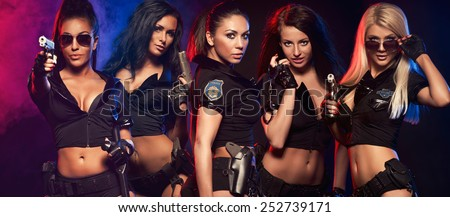 Group of sexy woman like police woman  - stock photo