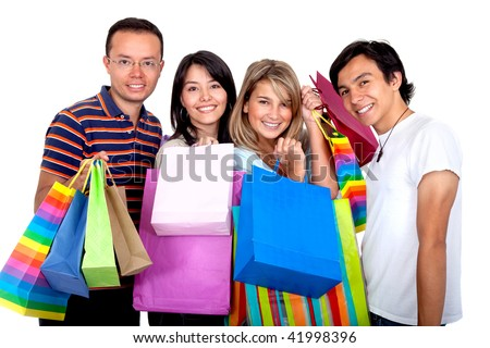 Group of shopping friends with some bags isolated over white - stock photo
