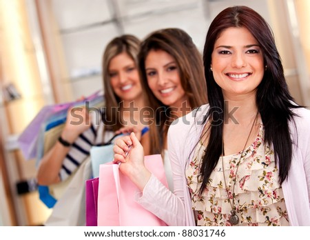 Group of shopping girls holding bags and smiling