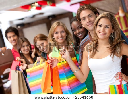 group of shopping people  in a mall with some bags - stock photo