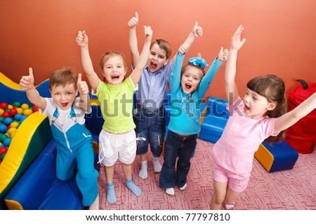 Group of shouting kids with hands up - stock photo