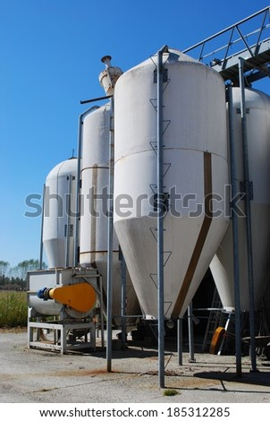 Group of silos for storing grain in a farm - stock photo