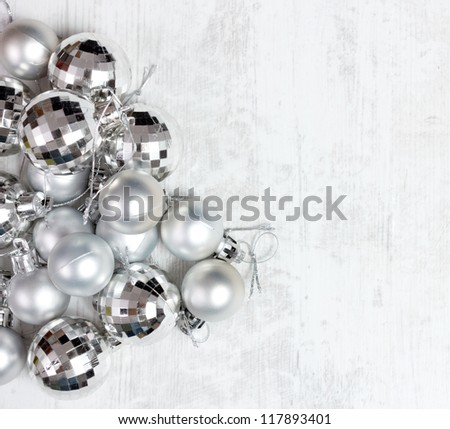 Group of silver baubles against wooden white table.Top view. - stock photo