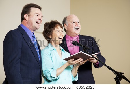 Group of singers on stage.  Focus on woman in middle. - stock photo